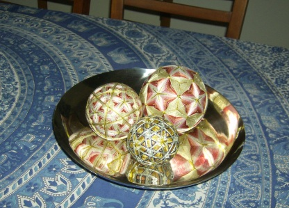 Thread wrapped balls in a West Elm bowl. Photo by Holly Tierney-Bedord. All rights reserved.