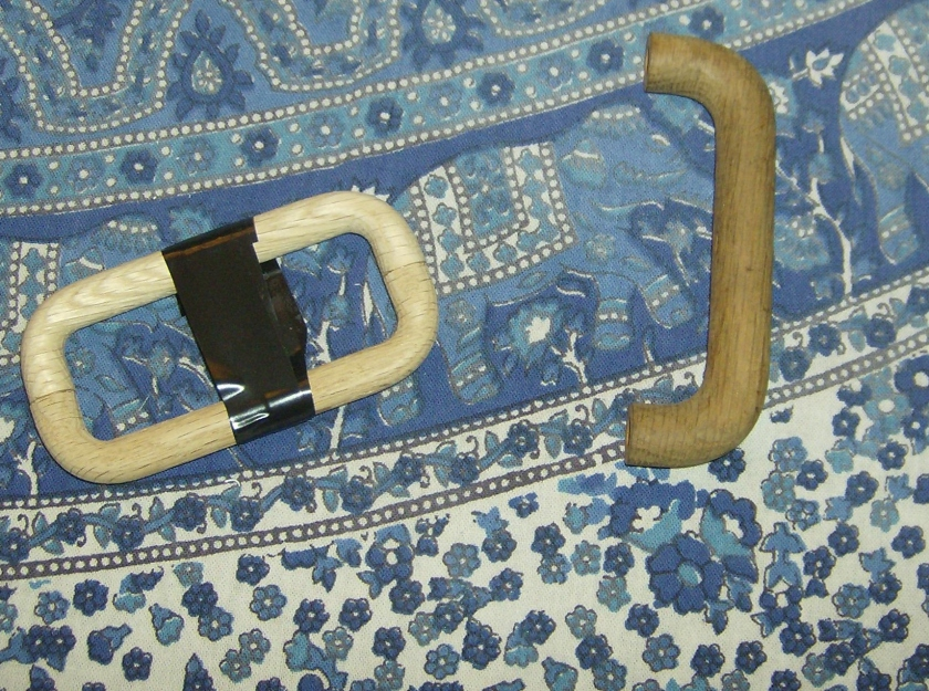 Two wooden handles held with tape while the glue dries. Another in case you are confused. Photo by Holly Tierney-Bedord. All rights reserved.