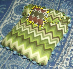 Mini bed with pompom details. Photos by Holly Tierney-Bedord. All rights reserved.