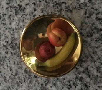A mid-century knob becomes a mini bowl of fruit. Photo by Holly Tierney-Bedord. All rights reserved.