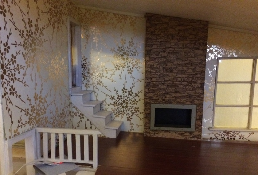 Installing wallpaper. Photo by Holly Tierney-Bedord. All rights reserved.