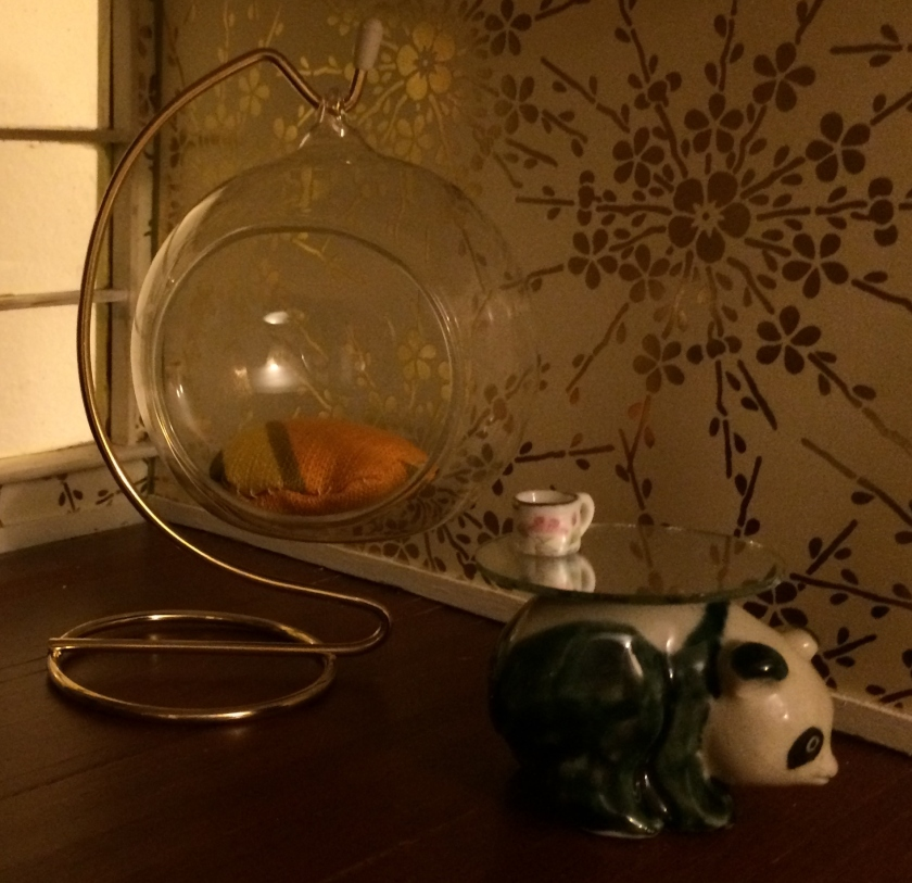 Panda figurine and some mirrors. Photo by Holly Tierney-Bedord. All rights reserved.